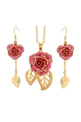 Rose trempée d'or avec ensemble de bijoux roses. Style feuille